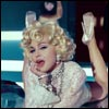 Madonna in the Give Me All Your Luvin' video
